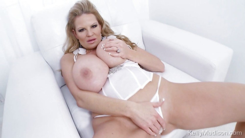 Big titted Kelly Madison exposes her massive tits